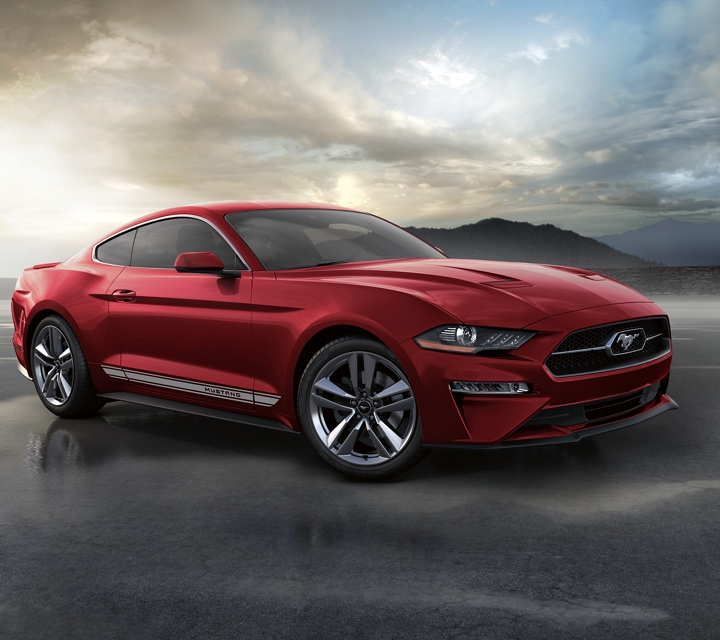 2020 Ford Mustang with the pony package on a beach with a mountain in the background