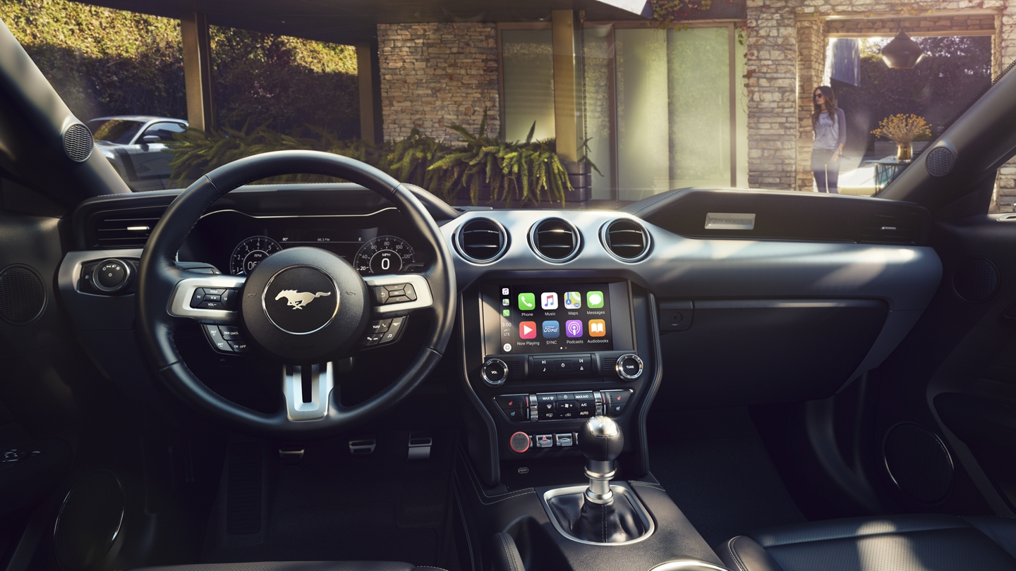 Behind the wheel of a 2020 Ford Mustang