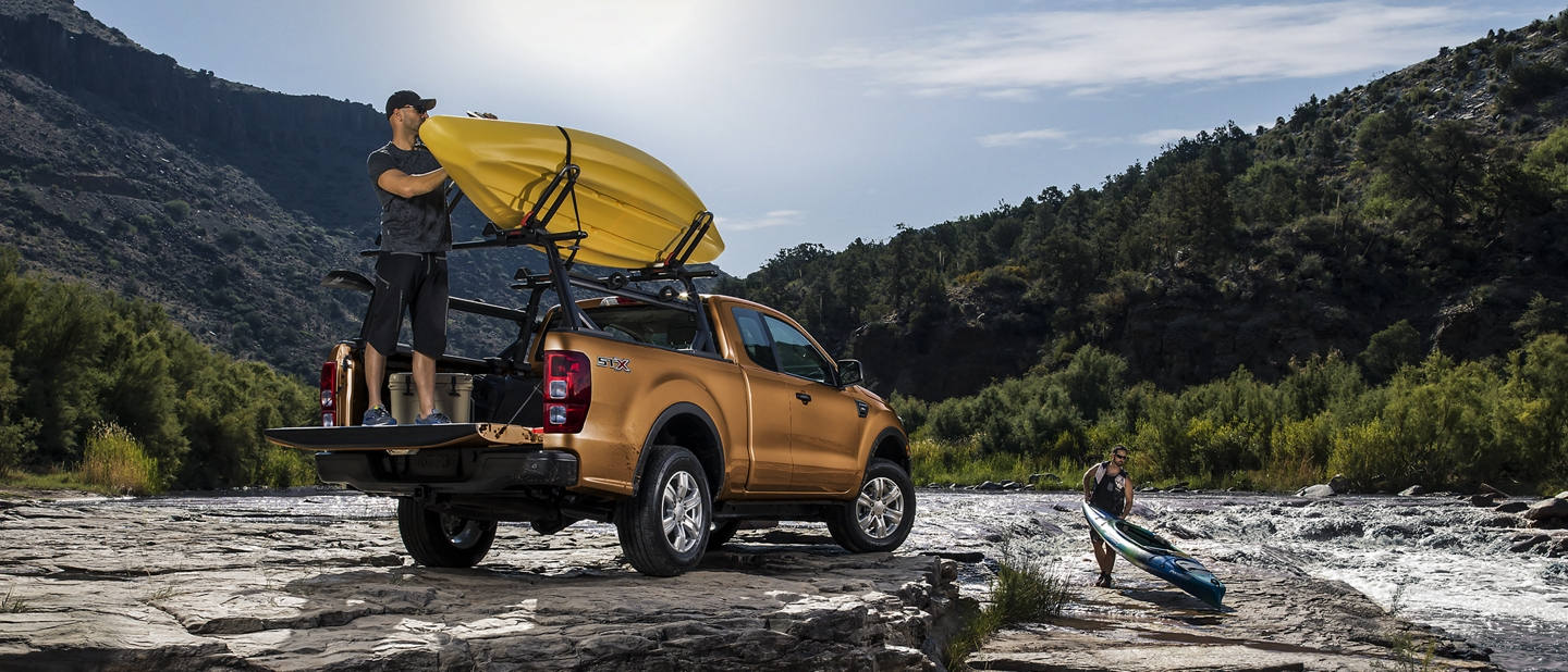 2019 Ford Ranger at riverbank with man unloading kayak