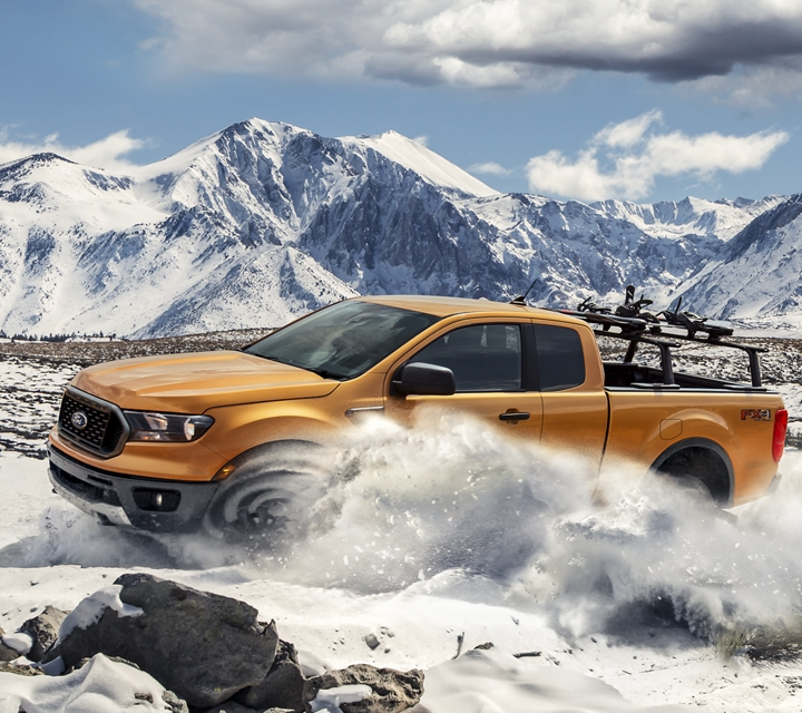 2019 Ford Ranger on snow covered mountain terrain with optional bed mounted rack accessory