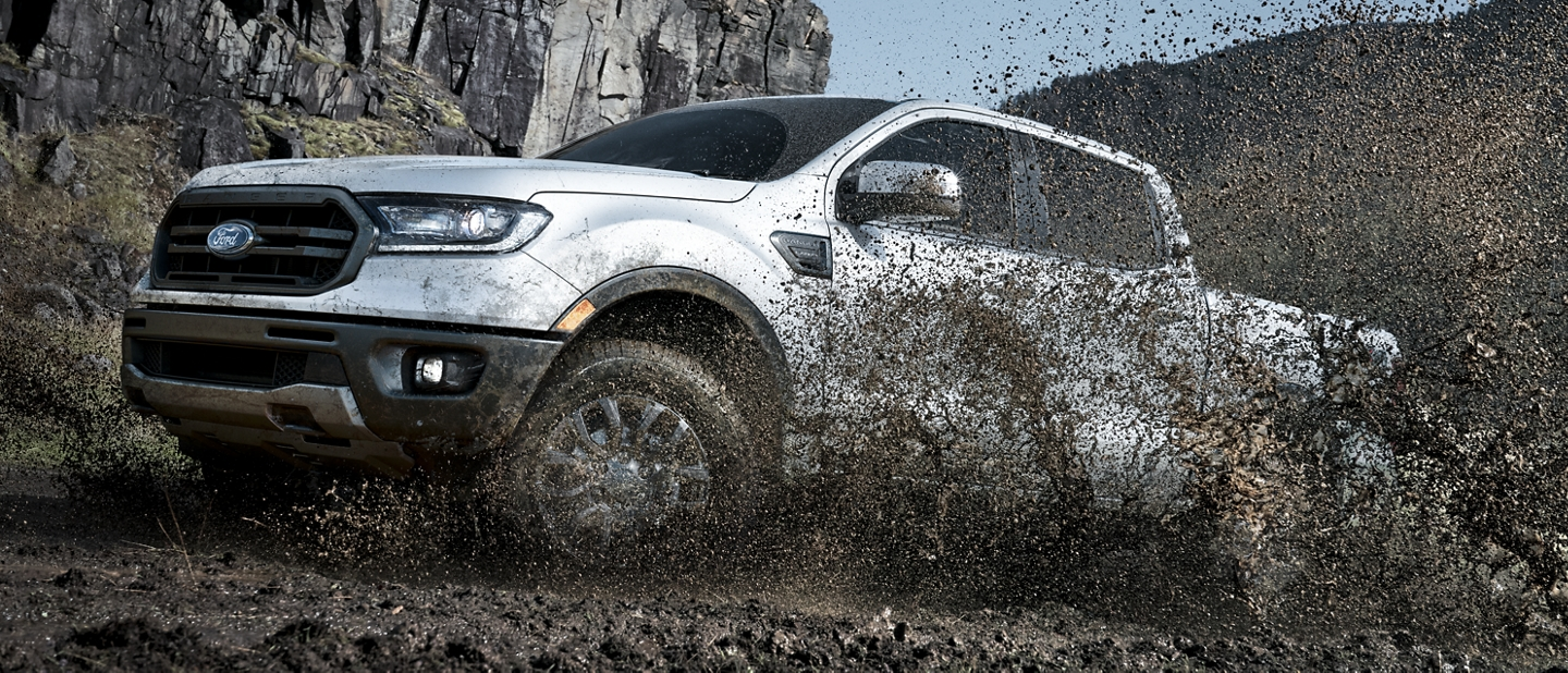 2020 Ford Ranger LARIAT F X 4 in Oxford White shown kicking up dust