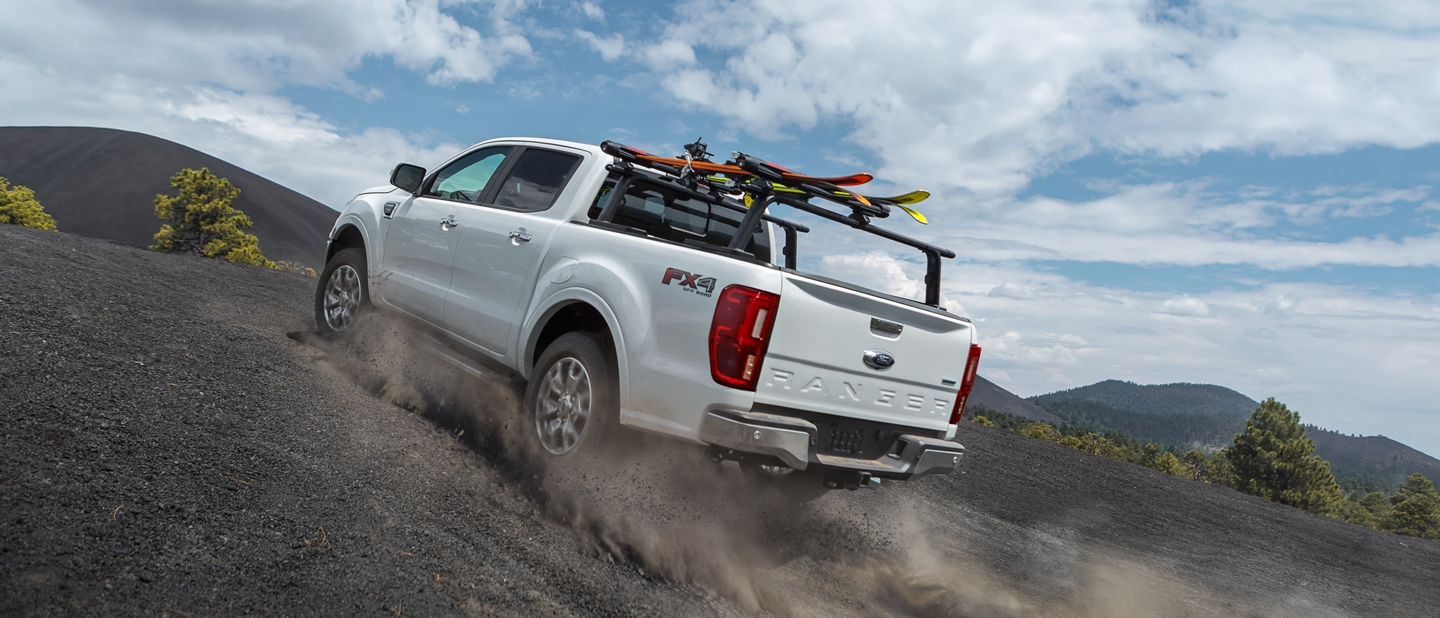 2020 Ford Ranger LARIAT F X 4 in Oxford White being driven uphill