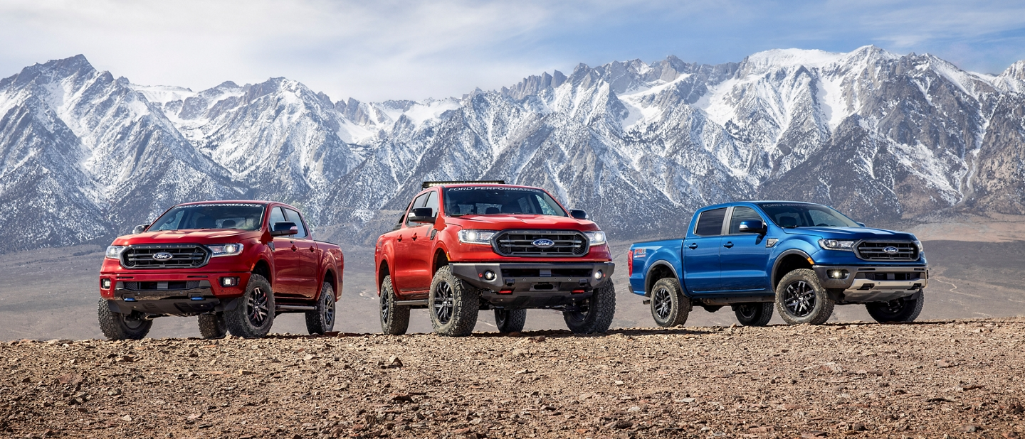 Various 2020 Ford Ranger models with Ford Performance Packages parked on dirt in front of mountain landscape