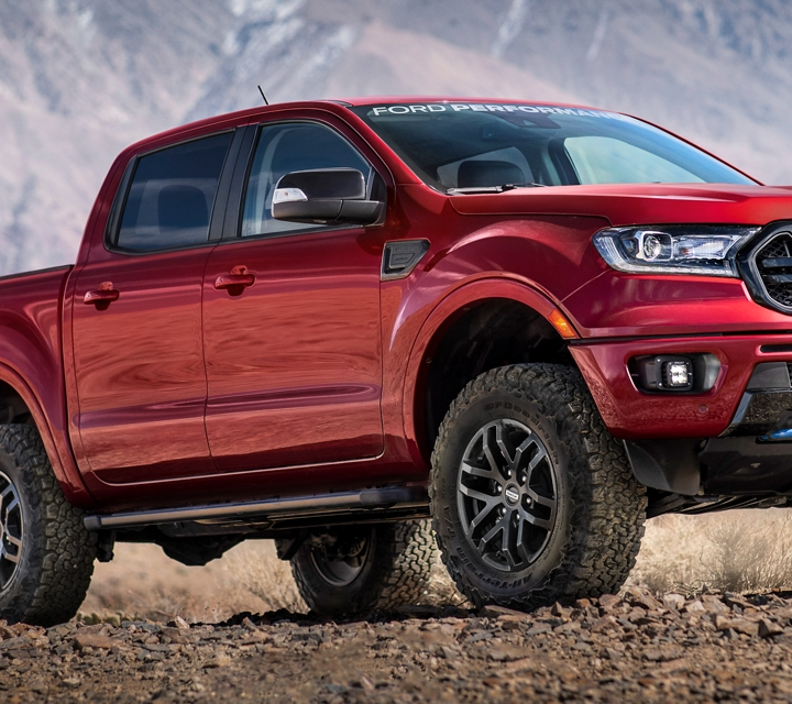 2020 Ford Ranger with Ford Performance Level 2 Package in Rapid Red parked on dirt with mountains in background