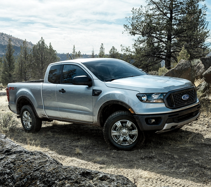 2020 Ford Ranger in Iconic Silver on a mountain road with trail bikers riding around it