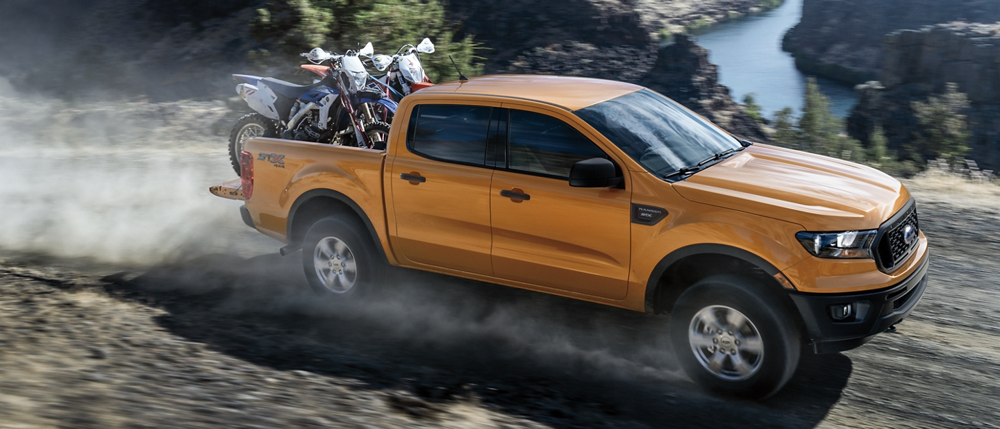 2020 Ford Ranger in Saber hauling a pair of motorcycles