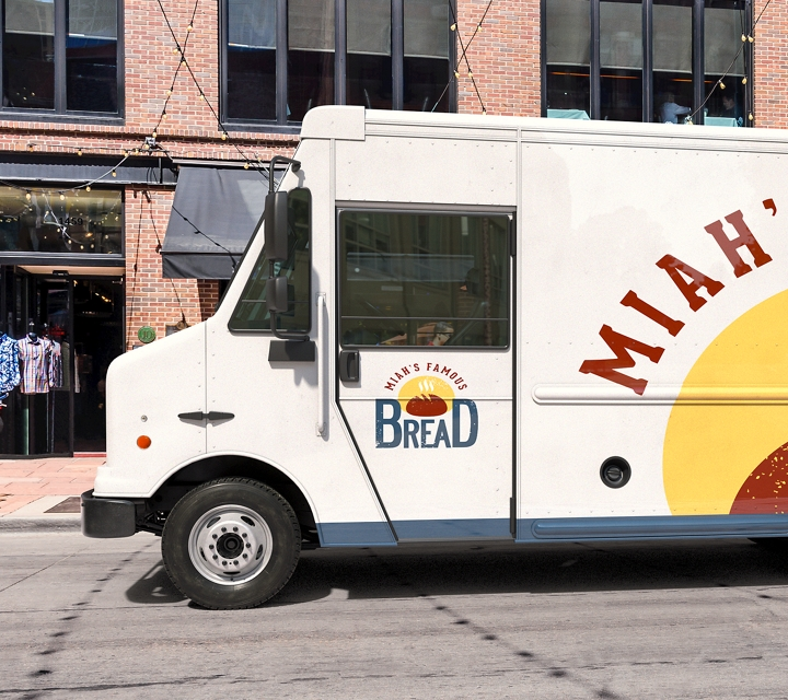 A bakery delivery van parked on a street corner