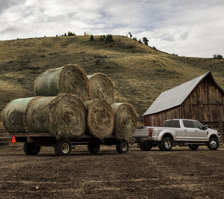 A 2020 Super Duty tows heavy bales on hay on a ranch