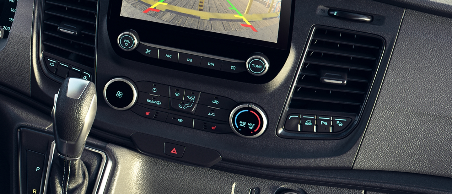 A close up of the 2020 Ford Transit center screen and gear shifter