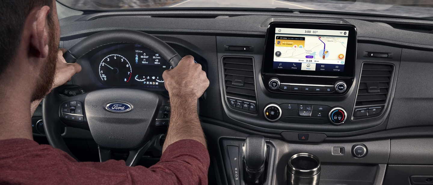 A man behind the wheel of a 2020 Ford Transit