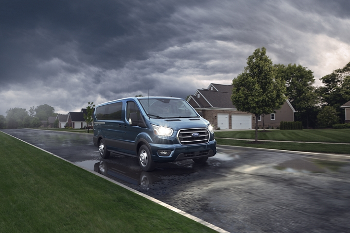 A 2020 Ford Transit parked on a suburban street
