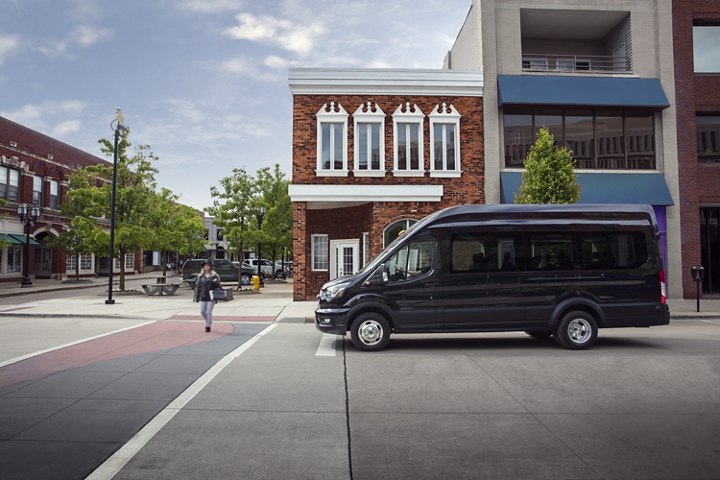 A 2020 Ford Transit stopped at an intersection