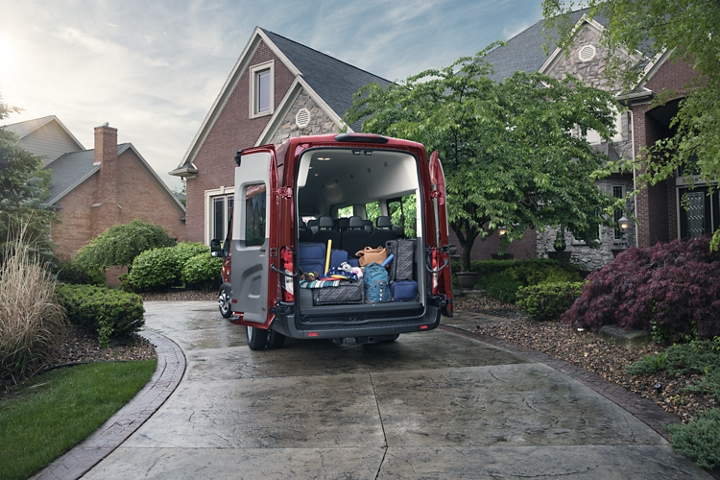 A 2020 Transit with open rear cargo doors showing luggage