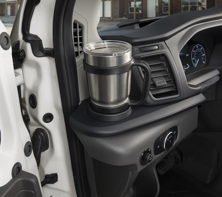 A coffee mug in the left side cupholder
