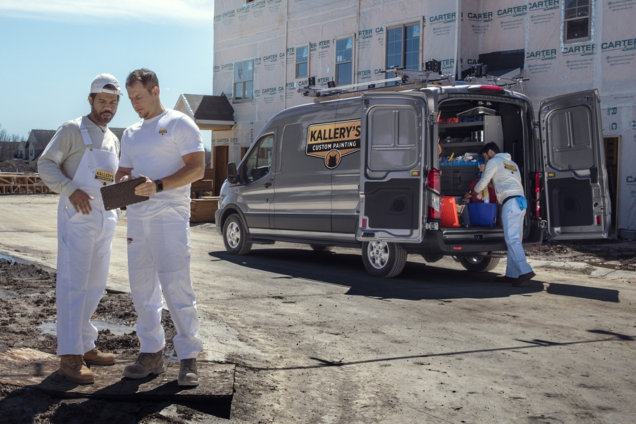 People working at a construction site around a 2020 Ford Transit