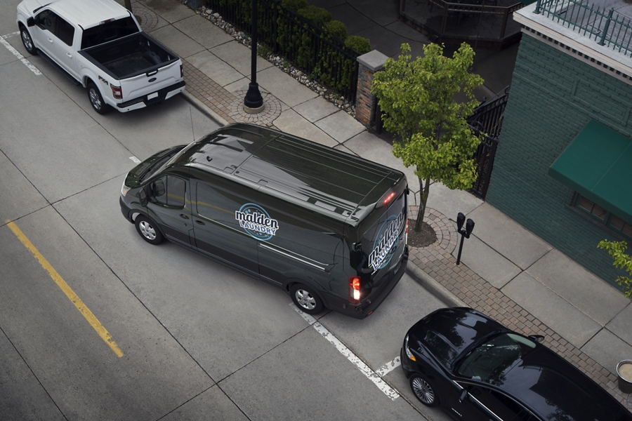 A 2020 Transit Commercial being parallel parked