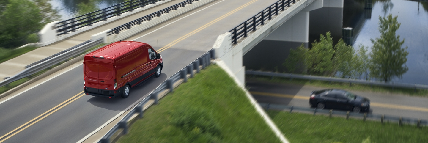 A 2020 Ford Transit being driven across a bridge