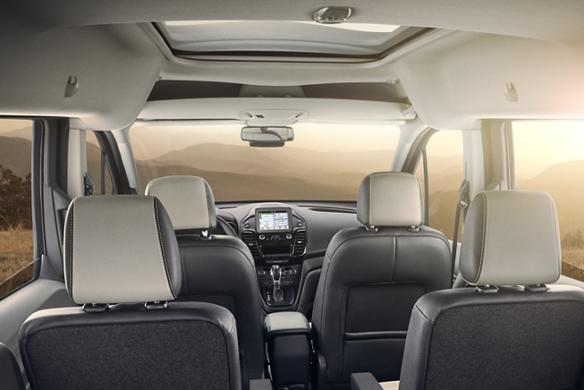 2020 Transit Connect Passenger Wagon interior seeing sun shine through the windshield that also has an available panoramic fixed glass Vista Roof