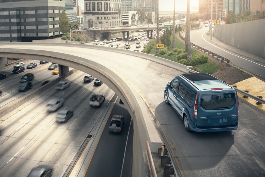 Blue 2020 Ford Transit Connect Passenger Wagon on the highway during the daytime on a nice sunny day