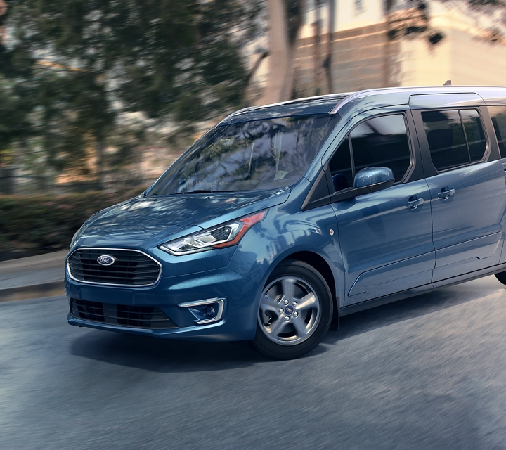 Blue Metallic 2020 Ford Transit Connect Passenger Wagon getting around in the city