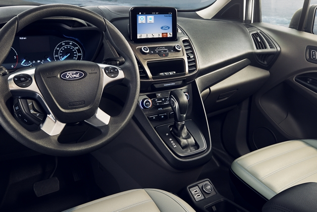 Interior view of Transit Connect Passenger Wagon with available features that include the available wireless charging feature