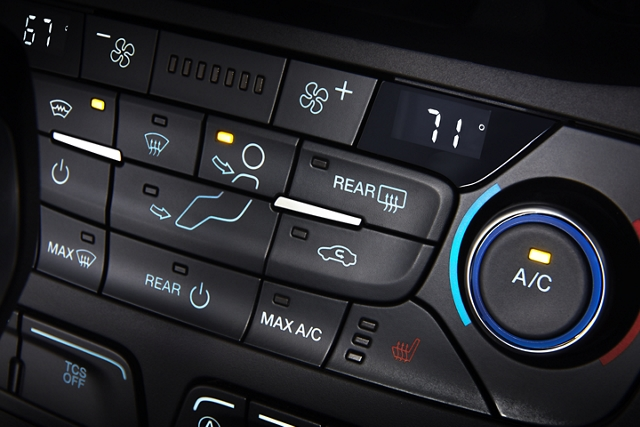 Panel controls for the available Quickclear electric windshield defroster