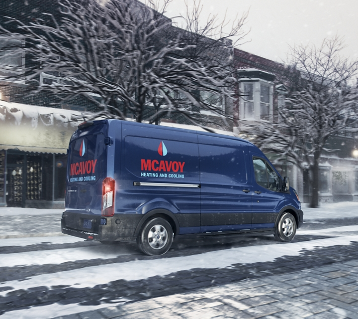 A transit cargo van at work on a snowy day