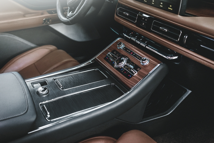 The front center console is shown to highlight aviation inspired materials used throughout the cabin