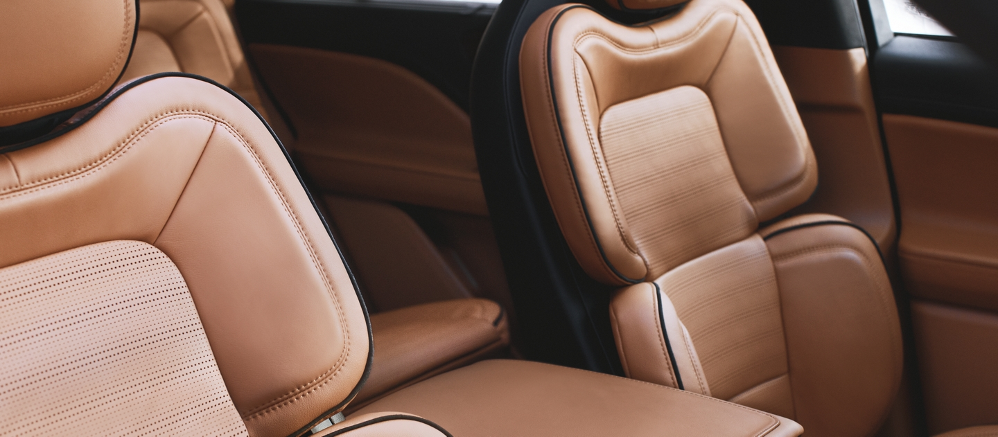 The front row perfect position seats are shown in a rich luggage tan inspired interior color