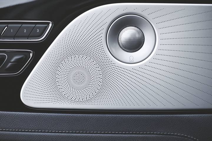 One of the 28 speakers in the Revel three D audio system is shown