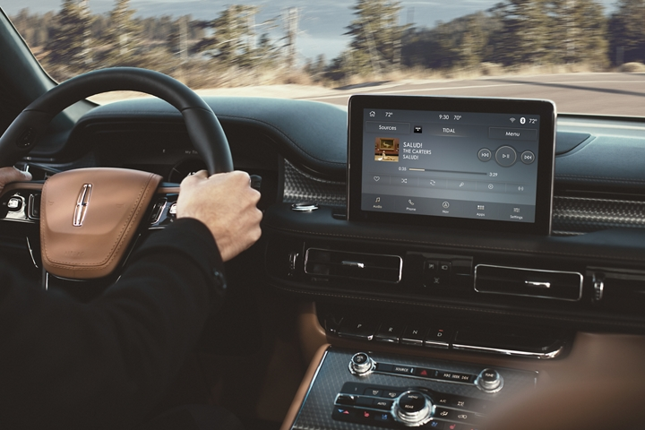 The TIDAL screen is shown in the center console of a Lincoln Aviator