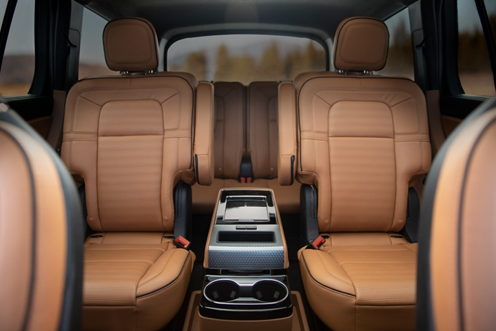 The interior of a Lincoln Aviator Black Label in the Flight theme is shown from the front row looking backward to the third row
