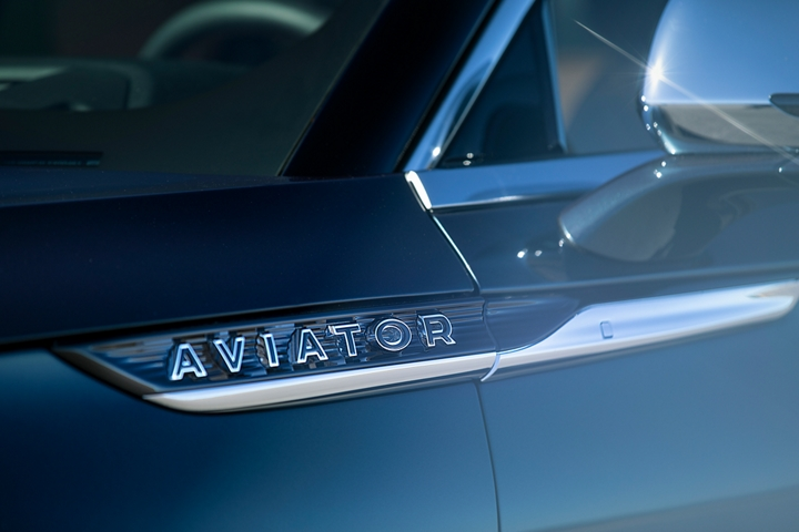 The Pillar Black lettering of the Lincoln Aviator Black Label badge is shown on the belt line of the vehicle