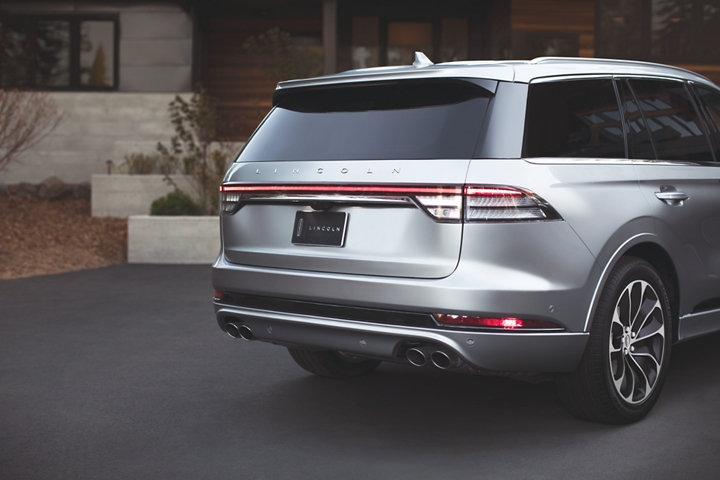 The rear taillamps of the Lincoln Aviator are shown spanning the entire width of the back of the vehicle