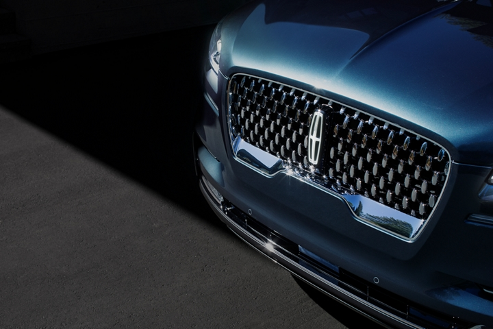 The Lincoln Aviator Black Label grille is shown with raised Lincoln star logo like shapes surrounding the center Lincoln emblem