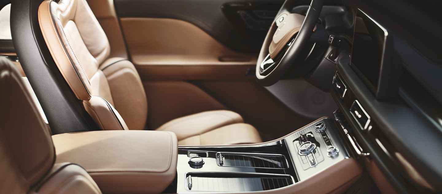 The interior of a 2021 Lincoln Aviator is shown with multiple hotspots that can be clicked for more information