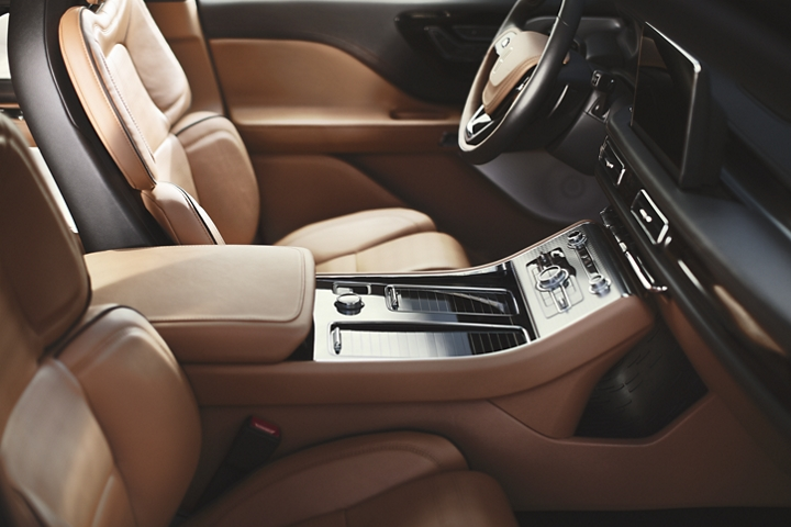 The front console is shown highlighting the space style and controls that are easily within reach