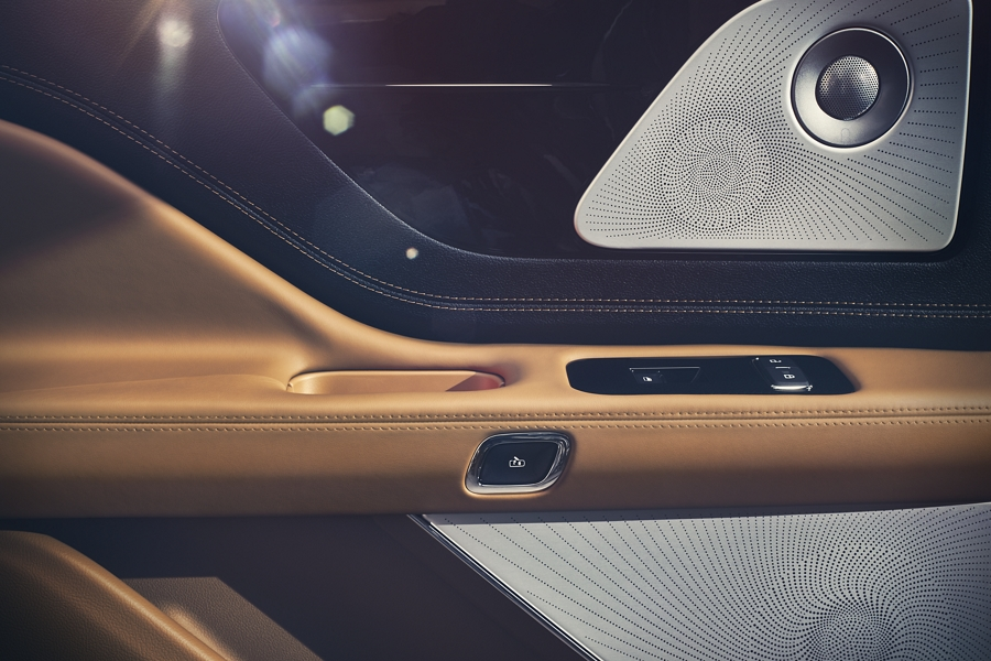 A speaker from the 28 speaker audio system is shown nicely placed within the passenger front door