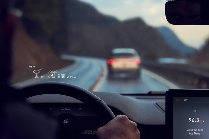 Vital information in the head up display is shown being projected on the windshield in the eyeline of the driver