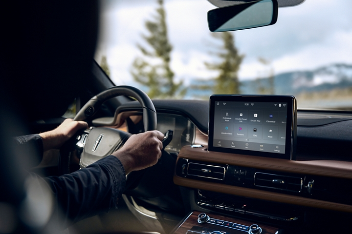 The Lincoln plus alexa app is shown in the center screen of a 2021 Lincoln Aviators dashboard