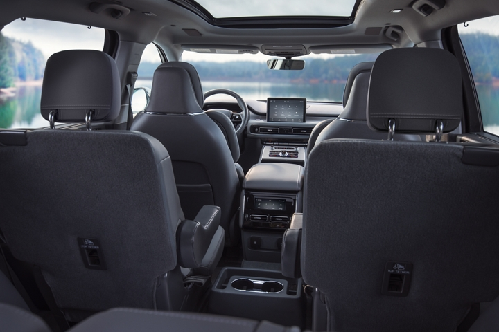 The interior of a 2021 Lincoln Aviator is shown from the perspective of the third row