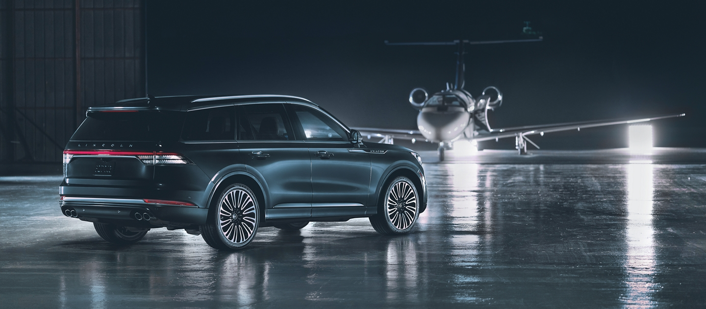 A 2021 Lincoln Aviator Black Label is shown parked on the tarmac of a private airport