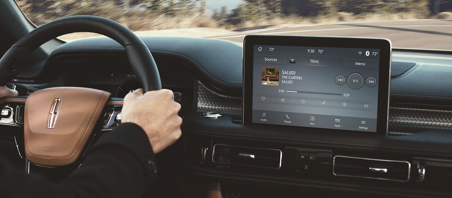 Tidal a streaming music and entertainment service is shown in the center screen of a 2021 Lincoln Aviator