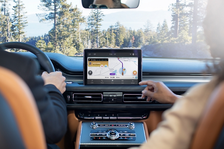 The front passenger is shown interacting with the waze app in the center screen of the 2021 Lincoln Aviator