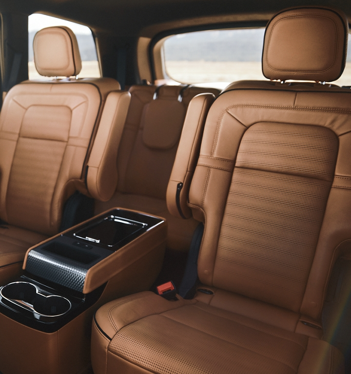 The Second row of a 2021 Lincoln Aviator is shown with the optional center console positioned between the two captains chairs