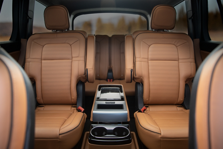 The interior of a 2021 Lincoln Aviator Black Label in the Flight theme is shown from the front row looking backward to the third row