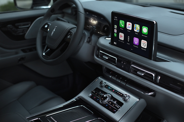 The center consoles touchscreen is shown displaying a number of smartphone compatible capabilities