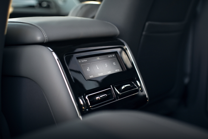 Temperature controls are shown on the back of the front row console
