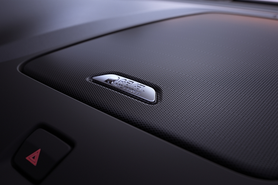 This is an image of a sound system speaker located in the center of the dashboard