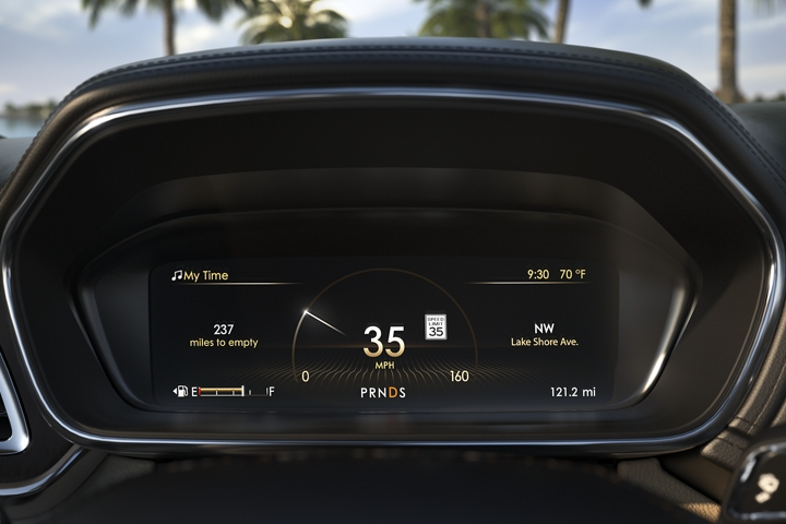 The single screen driver information center is shown displaying vehicle information that is important to the driver